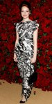 Emma Stone in a black & white abstract printed Chanel column gown with a Chanel chain strap bag