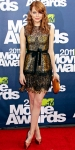 Emma Stone in a lace Bottega Veneta dress with Casadei stilettos