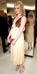 Emma Stone in a Louis Vuitton drop-waist dress with tie-dye Louboutins