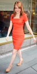 Emma Stone in a persimmon sheath dress with suede Brian Atwood pumps & gold House of Lavande earrings