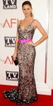 Gisele Bundchen in a pewter Oscar de la Renta gown with pink belt & Jack Vartanian jewelry