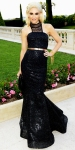 Gwen Stefani in a black L.A.M.B. mermaid gown with a Roger Vivier clutch