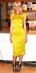 Gwyneth Paltrow in a yellow satin Tachel Roy sheath with a Giles & Brother necklace, & metallic Camilla Skovgaard heels