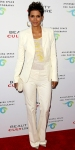Halle Berry in a white Roberto Cavalli suit with Bavna earrings & a clutch by Kelly Locke
