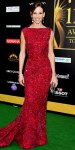 Hilary Swank in an embroidered Elie Saab fishtail gown with a Judith Leiber clutch