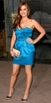 Isla Fisher in an electric blue Temperley London mini dress with satin shoes
