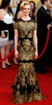 January Jones in a golden lace Carolina Herrera gown with Lorraine Schwartz jewels