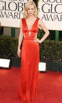 January Jones in a red plunging Versace fringe gown with Neil Lane bangles