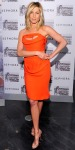 Jennifer Aniston in an orange Vivienne Westwood dress with strappy Christian Louboutin sandals