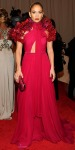Jennifer Lopez in a fuchsia Gucci gown with a python minaudiere