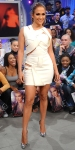 Jennifer Lopez in a peek-a-boo Hakaan LWD with silver heels & hoops