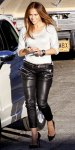 Jennifer Lopez in an H&M sweater with leather pants by Balmain & studded Christian Louboutin heels