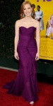 Jessica Chastain in a ruched plum Oscar de la Renta dress with earrings by Sutra & Jimmy Choo heels