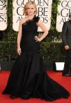Julia Stiles in a black tulle Romona Keveza gown with H. Stern jewelry