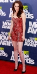 Kristen Stewart in a pinned red leather Balmain mini dress