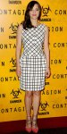 Marion Cotillard in a Christian Dior print dress with coral chain strap pumps