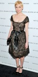Michelle Williams in a belted lace Oscar de la Renta dress with Salvatore Ferragamo heels