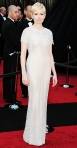 Michelle Williams in a shot-sleeve Chanel column gown with Jimmy Choo heels & Harry Winston diamond earrings