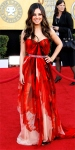 Mila Kunis in a printed Alexander McQueen gown with Cartier jewelry