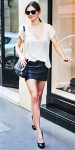 Miranda Kerr in a Victoria's Secret tee with a leather mini skirt & a chain-strap bag