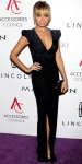 Nicole Richie in a plunging black Antonio Berardi gown with Sergio Rossi pumps & a clutch from House of Harlow 1960