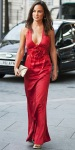 Pippa Middleton in a red plunging Temperley London colum gown with gold accessories