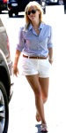 Reese Witherspoon in a cuffed blouse with belted white shorts with Gerard Darel flats