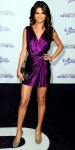 Selena Gomez in a jewel-tone Reem Acra mini dress with crystal-studded heels, a M.C.L. by Matthew Campbell Laurenza ring & structured clutch