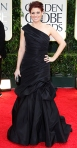 Debra Messing in a black Monique Lhuillier with purple Lorraine Schwartz jewelry & a Marchesa minaudiere