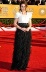 Emilia Clarke in a black & white feathered Chanel gown
