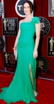 Emily Blunt in an emerald Oscar de la Renta one-shoulder gown