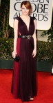 Emma Stone in a layered Lanvin gown with a bag by Cartier