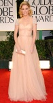 Julie Bowen in a blush Reem Acra gown with Martin Katz gems, a Judith Leiber clutch, & Casadei heels