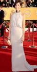 Kristen Wiig in a nude Balenciaga halter gown