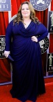 Melissa McCarthy in a navy draped Badgley Mischka gown