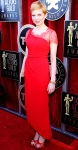 Michelle Williams in a red lace Valentino gown