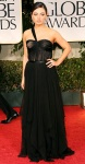 Mila Kunis in a black Christian Dior gown with Cartier jewels