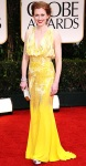 Mireille Enos in a yellow metallic Naeem Khan gown with a Salvatore Ferragamo clutch