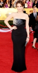Tina Fey in a black beaded vintage Versace gown