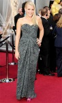 Busy Philipps in a gathered lace Dolce & Gabbana column gown with Irene Neuwirth earrings