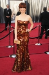 Ellie Kemper in a bronze sequined Armani Prive gown with Lorraine Schwartz jewelry & a Salvatore Ferragamo clutch