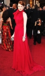 Emma Stone in a scarlet Giambattista Valli dress with Louis Vuitton shoes