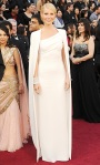 Gwyneth Paltrow in a white Tom Ford floor length gown & cape with an Anna Hu Haute Joaillerie diamond cuff & ring