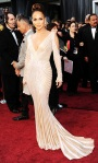 Jennifer Lopez in a plunging Zuhair Murad curve-hugging gown with Lorraine Schwartz jewelry & a Ferragamo clutch