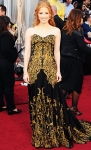 Jessica Chastain in a black & gold intricate lace overlacy Alexander McQueen gown with yellow diamonds from Harry Winston