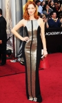 Judy Greer in a sleek silver & black Monique Lhuillier column gown with a clutch by Judith Leiber