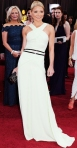 Kelly Ripa in a white belted Carolina Herrera gown with Fred Leighton jewelry & a Judith Leiber clutch