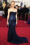 Leslie Mann in a navy sequined Roberto Cavalli down with a Judith Leiber clutch