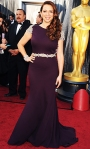 Maya Rudolph in a plum cap sleeve embellished Johanna Johnson gown & Neil Lane diamonds