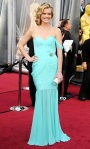 Missi Pyle in an organic silk gown by Valentina Delfino with Chopard diamonds & a Swarovski roll clutch